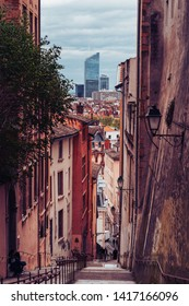 Lyon, France - May 9, 2019. View at Part Dieu from a charming, narrow alley in Vieux Lyon, the old town of Lyon.