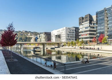 LYON, FRANCE - NOV 1, 2016: famous Confluence District with people in Lyon, France with river. The modern architecture is famous and has won a lot of prizes.