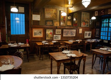LYON, FRANCE- OCTOBER 10, 2017: interior of Bouchon -traditional local restaurant in Lyon where you eat specialties from Lyon and the region. There are 30 Bouchons in Lyon, France