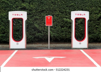 Lyon, France - October 22, 2016: Tesla supercharger station and parking. Tesla is an American automotive and energy storage company that designs, manufactures, and sells luxury electric cars