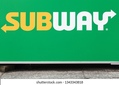Lyon, France- October 25, 2018: Subway logo on a wall. Subway is an American fast food restaurant franchise that primarily sells submarine sandwiches and salads