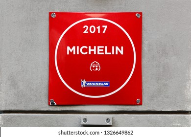 Lyon, France - September 20, 2017: Bib gourmand Michelin restaurant logo on a wall. A bib gourmand michelin restaurant offering exceptionally good food at moderate prices