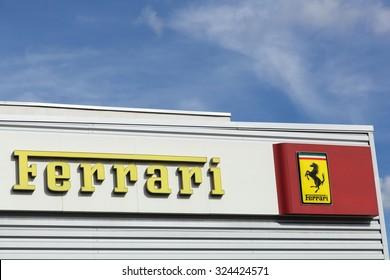 Lyon, France - September 25, 2015: Ferrari logo on a facade of a dealer.  Ferrari is an Italian luxury sports car manufacturer based in Maranello, Italy