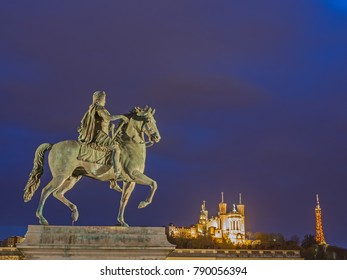 """Lyon at night with monument """"The horse"""" and church Notre-Dame de Fourviere"""