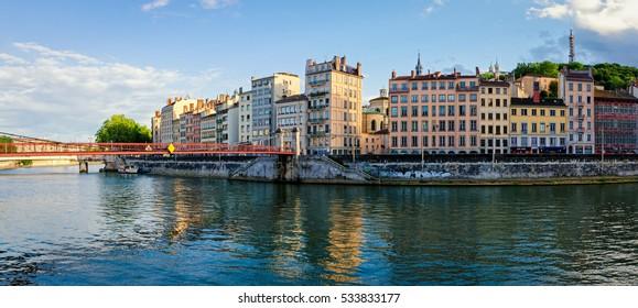 Lyon old buildings along river Saone at sunset
