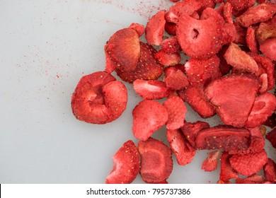 Lyophilized / freeze-dried strawberries isolated on white background.