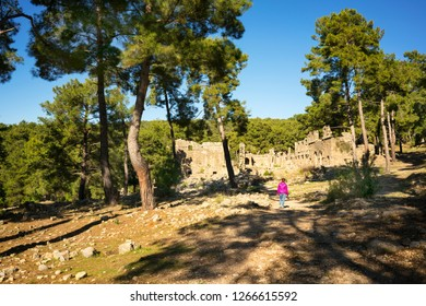Lyrbe, Manavgat/Turkey- December 22, 2018: Tourists are walking around in the remaining of ancient city Lyrbe at manavgat, Turkey