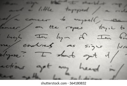 "Lyrics written in ink on paper, closeup/focus on the words ""I'm lyin if..."""