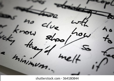 "Lyrics written in ink on paper, closeup/focus on the word ""school"""