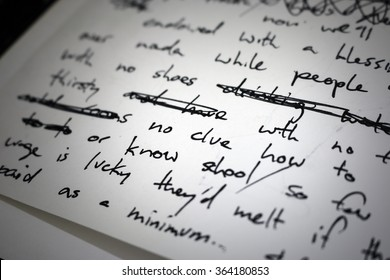 "Lyrics written in ink on paper, closeup/focus on the words ""no clue"""