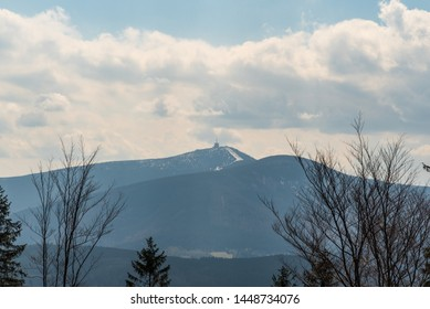 Lysa hora with nearest Travny hill from hiking trail near Kotar hut in Moravskoslezske Beskydy mountains in Czech republic during nice springtime day with blue sky and clouds