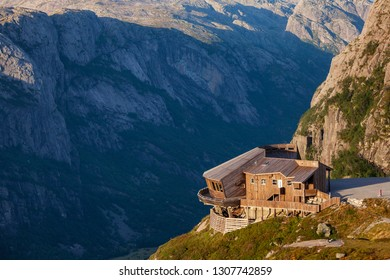 LYSEBOTN, NORWAY - AUGUST 13, 2018: Wooden building of Oygardstol panoramic restaurant overlooking Lysefjord at Øygardstølen, a starting point of mountain trail to Kjeragbolten