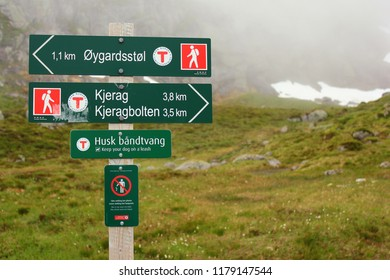 Lysebotn, Norway - June 12, 2018: Signpost showing direction and distance to Kjeragbolten, a boulder wedged in the mountain's crevasse on the mountain Kjerag and a popular tourist destination.
