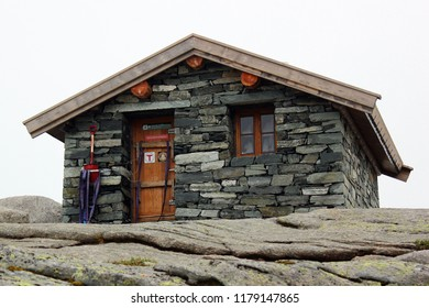 Lysebotn, Norway - June 12, 2018: Emergency shelter on the way to Kjeragbolten, a boulder wedged in the mountain's crevasse on mountain Kjerag and a popular tourist destination.