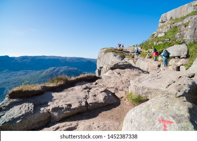 LYSEFJORD, NORWAY - JULY 26, 2018: Tourists on their way to the top of the  Pulpit rock. The Pulpit Rock or Preacher's Chair is a tourist attraction in the municipality of Forsand in Rogaland county