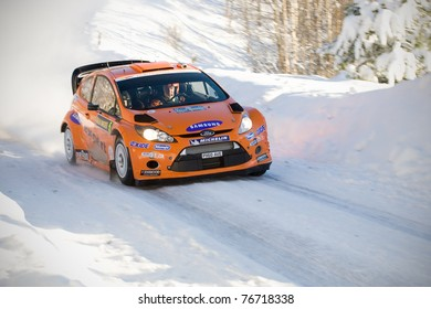LYSVIK, SWEDEN - FEB 11: Henning Solberg driving his Ford Fiesta WRC during the World Rally Championship event Rally Sweden in Lysvik, Sweden on Feb 11, 2011