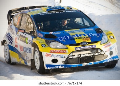 LYSVIK, SWEDEN - FEB 11: PG Andersson driving his Ford Fiesta WRC during the WRC event Rally Sweden 2011 in Lysvik , Sweden on Feb 11, 2011