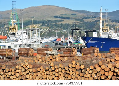 Lyttelton, New Zealand - May 23, 2015: Pine logs await export on ships docked at the port of Lyttelton in Christchurch.