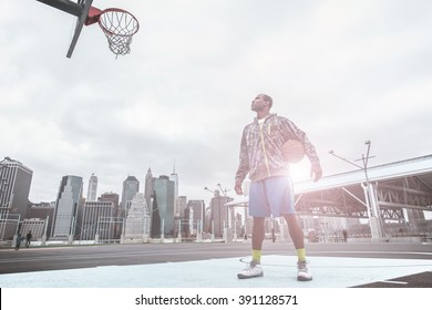 I m the champ. basketball player focus on the basket before performing slum dunks
