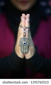 M. Ferri Setiawan/ A womam carry hamsa keychain.