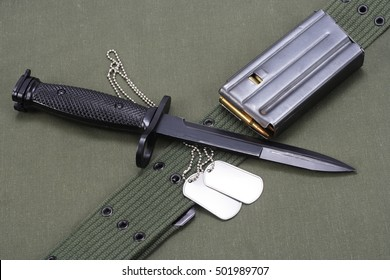M16 rifle bayonet on uniform background