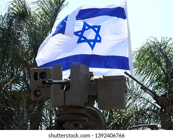 M2 heavy machine gun, browning .50 caliber (12.7 mm) mounted on Samson RCWS (Remote Controlled Weapon Station) of armored vehicle of the Israel Defense Forces with a waving Israeli flag in background