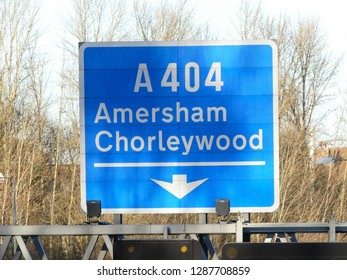 M25 Motorway exit sign at Junction 18 for Amersham and Chorleywood