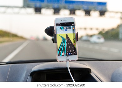 M25, UK - OCTOBER 15, 2017: Using TomTom GPS app on Apple iPhone while driving on M25 motorway
