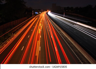 M3 Motorway, Surrey/ UK - June 17 2018: Overlooking the M3 motorway at night. The M3 now employs the controversial smart motorway system on which there are no hard shoulders.