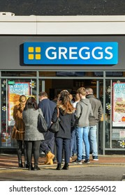 M4 SERVICES, READING, ENGLAND - NOVEMBER 2018: Customers queuing outside the door at the popular branch of Greggs bakery at the service station on the M4 in Reading.