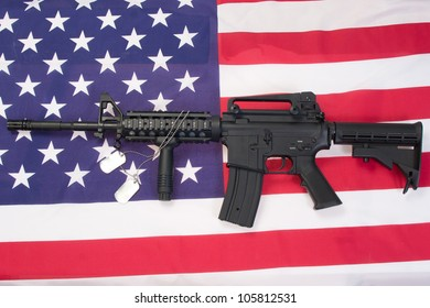 M4A1 assault rifle with blank dog tags on us flag