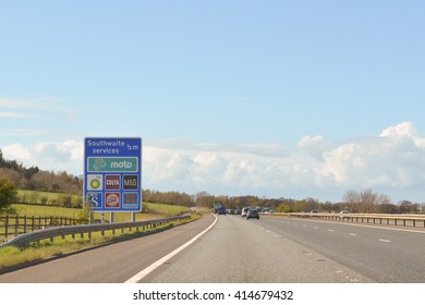 M6 MOTORWAY NORTHBOUND, ENGLAND, UK - 2 MAY 2016: motorway sign showing Southwaite services operated by moto