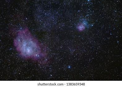 The M8 Lagoon Nebula and the M20 Trifid Nebula in the Sagittarius constellation seen from La Palma, Spain.