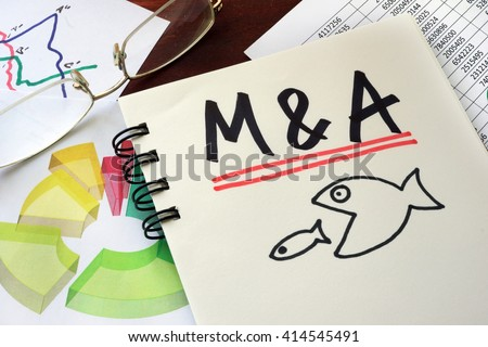 M&A Merger And Acquisitions written on a notepad.