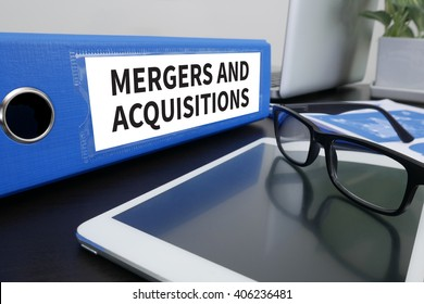 M&A (MERGERS AND ACQUISITIONS) Office folder on Desktop on table with Office Supplies. ipad