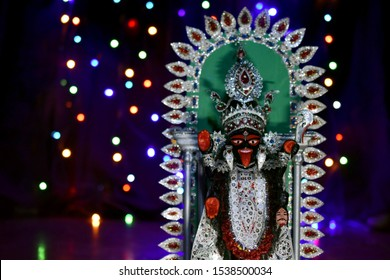 maa Kali in the Dark with blurred colourful lights background