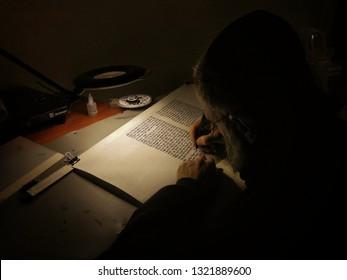 Maale Adumim, israel - 02 24 2019: Sofer Stam or Scribe Writing Megillat Esther