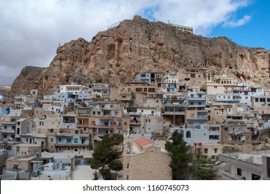 Maaloula / Syria - April 16, 2009 : The city view of Maaloula town where is built into the rugged mountainside.  It is known as one of three remaining villages where Western Neo-Aramaic is spoken.