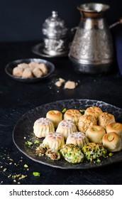 Maamoul or mamoul - arabic cookies stuffed dates with icing cugar on dark  background. Ramadan food. Arabian sweets