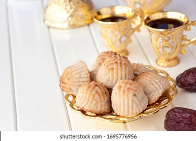 Maamoul traditional arab filled pastry or cookie with dates or cashew or walnut or almond or pistachios nuts. Eastern sweets. Close up. White wooden background.