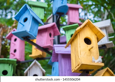 Maany colorful wooden bird houses on the tree
