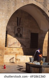 MA'ARAAT NUMAN, SYRIA - NOV 6, 1996 - Woman at well with portrait of Assad done in Roman mosaic style.