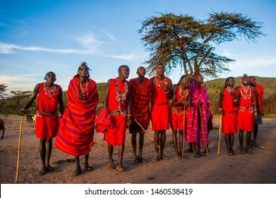 MAASAI MARA, KENYA - 16 AUGUST 2018: Maasai warriors are performing traditional dance to welcome tourist.