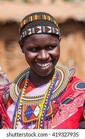 MAASAI MARA, KENYA - AUG 20, 2008: Massai woman poses for a portrait