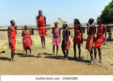 MAASAI MARA, KENYA - AUGUST 12: Maasai men in traditional clothing August 12, 2010 at Masaai Mara, Kenya. The Maasai are the most famous tribe in Africa. They are nomadic and live in small villages.