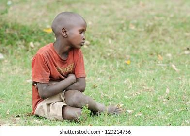 MAASAI MARA, KENYA - NOVEMBER 10: Portrait of unidentified Maasai boy on November 10, 2012 in Maasai Mara, Kenya. Maasai are a Nilotic ethnic group of semi-nomadic people located in Kenya.