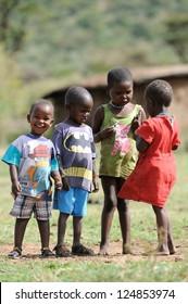 MAASAI MARA, KENYA - NOVEMBER 10: Portrait of unidentified Maasai children on November 10, 2012 in Maasai Mara, Kenya. Maasai are a Nilotic ethnic group of semi-nomadic people located in Kenya