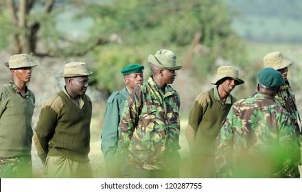 MAASAI MARA, KENYA - NOVEMBER 9: Group of Rangers men on November 9, 2012 in Maasai Mara, Kenya. Park rangers protect wildlife by enforcing park rules.