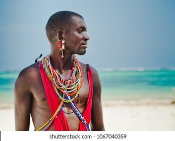 Maasai warrior on the beach. Diani Beach, Kenya Mombasa January 26 2012