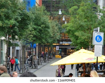 Maastricht, Holland- 30 th of August, 2014: Maastrichter Brugstraat- one of central pedestrian streets in Maastricht